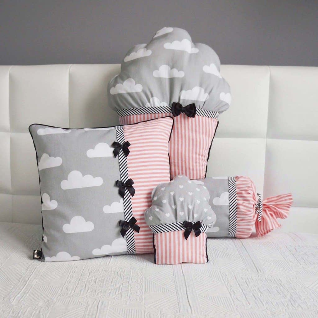 different shaped cushions placed on the bed to decorate kids room