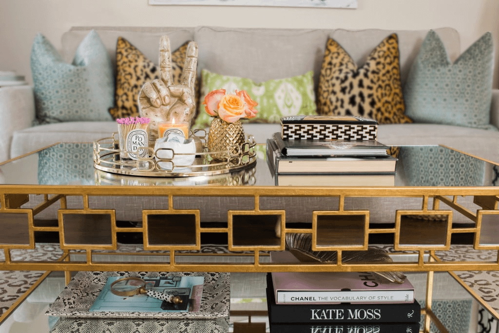 A coffee table styled aesthetically and placed in a living room