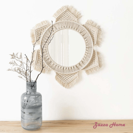 macrame fringed mirror displayed on wall