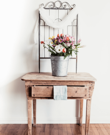 antique table with antique window frame and flower bouquet for cottagecore aesthetic