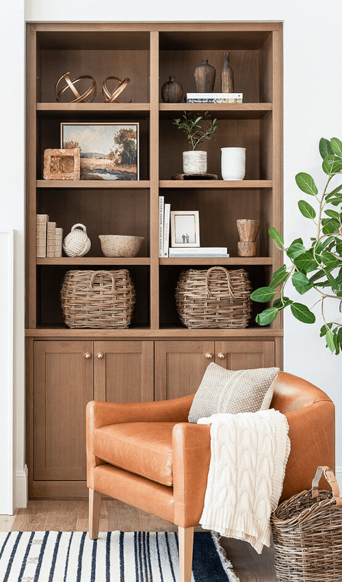 functional shelf styling with baskets and bowls as catch-alls